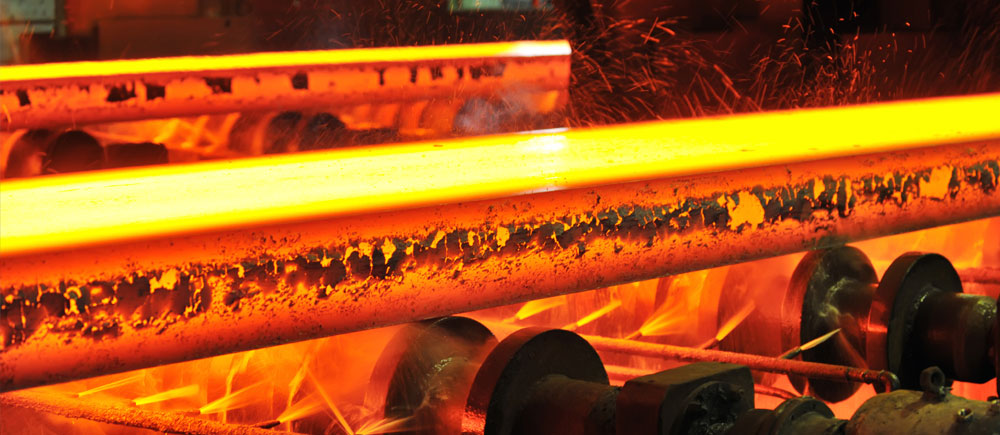 hot steel on conveyor in a steel mill